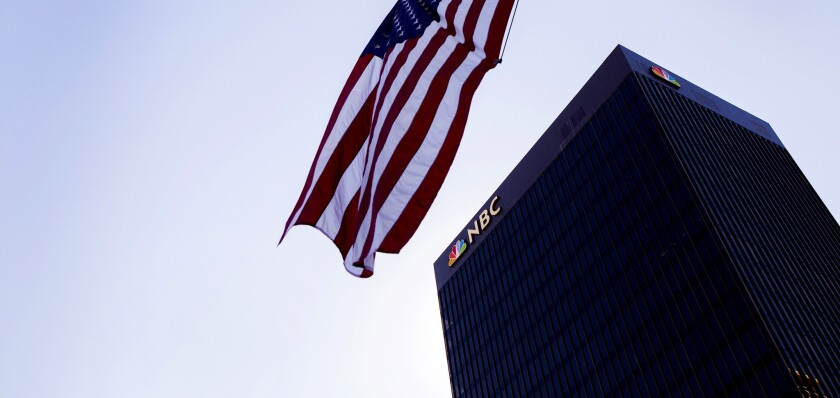 NBC News building seen with an American flag