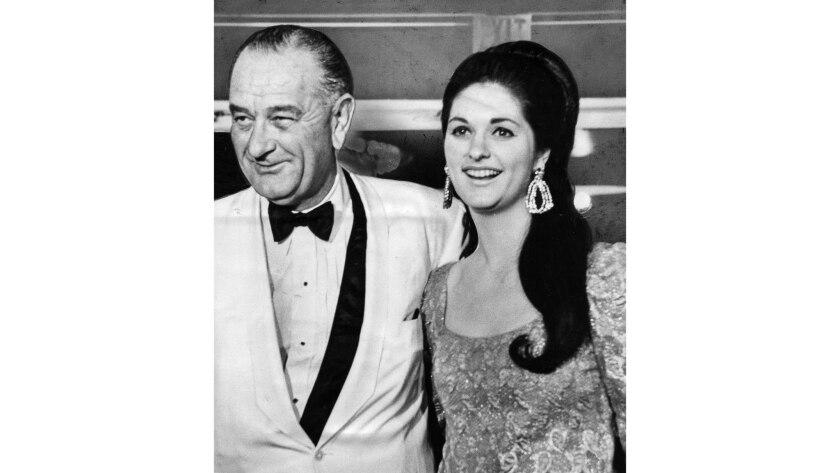 June 23, 1967: President Lyndon Johnson escorts his daughter Lynda Bird to a dinner at the Century P