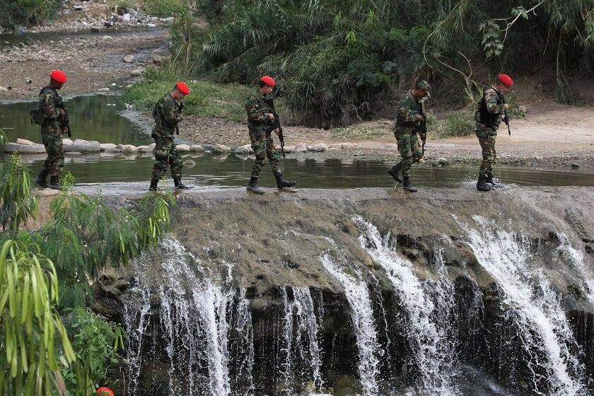 Venezuelan troops patrol a checkpoint in San Antonio, Tachira state, which is near the border with Colombia, on Sunday.