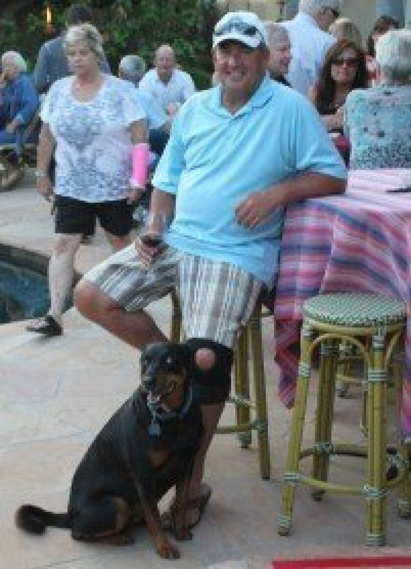 Steve Schreiner and his canine companion, Jackie, enjoy a 'Taco Tuesday' event at the home of Bob and Kim