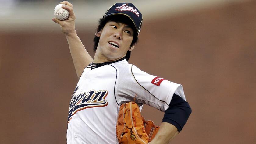 Japan's Kenta Maeda delivers a pitch during the first inning against Puerto Rico in a World Baseball Classic semifinal on March 17, 2013.