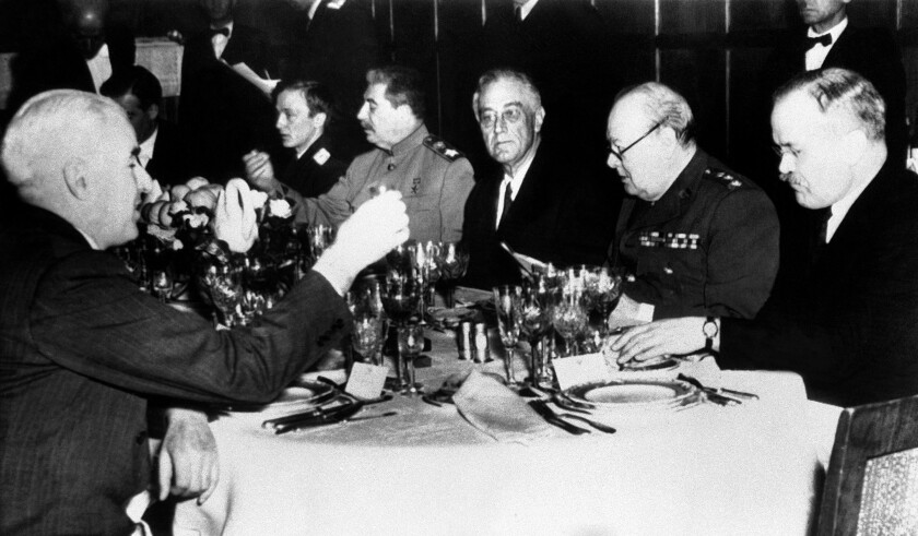 Winston Churchill with other world leaders at a dinner in 1945