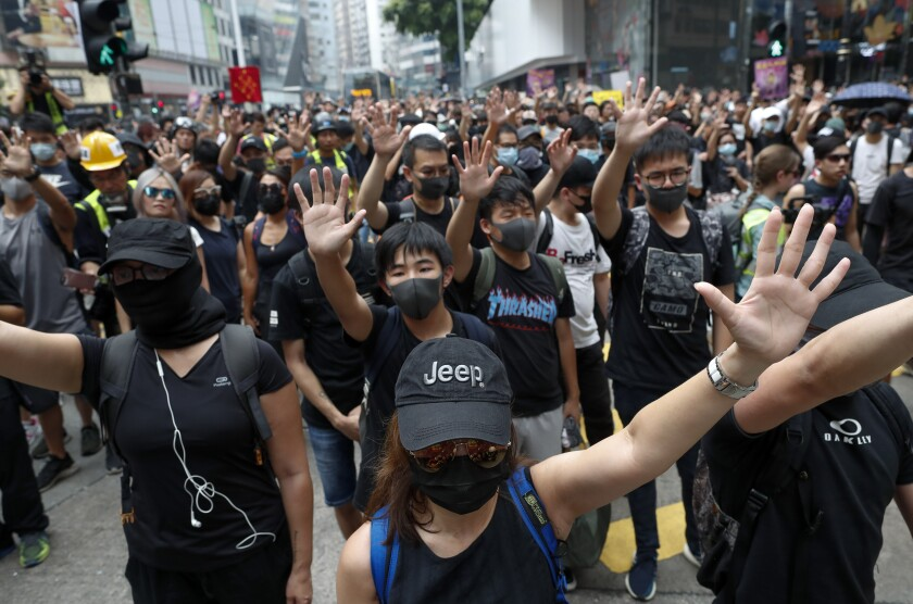 Protestors shout slogans in Hong Kong, Sunday, Sept. 29, 2019. Protesters and police clashed in Hong Kong for a second straight day on Sunday, throwing the city's business and shopping belt into chaos and sparking fears of more ugly scenes leading up to China's National Day this week. (AP Photo/Gemunu Amarasinghe)