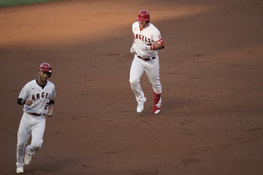 The Angels' Mike Trout and Andrelton Simmons round the bases on Trout's two-run homer.