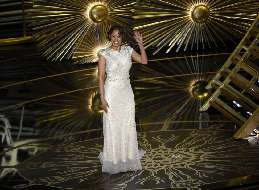 "Outspoken conservative Stacey Dash onstage at the Oscars after being introduced by host Chris Rock as ""director of minority outreach."""