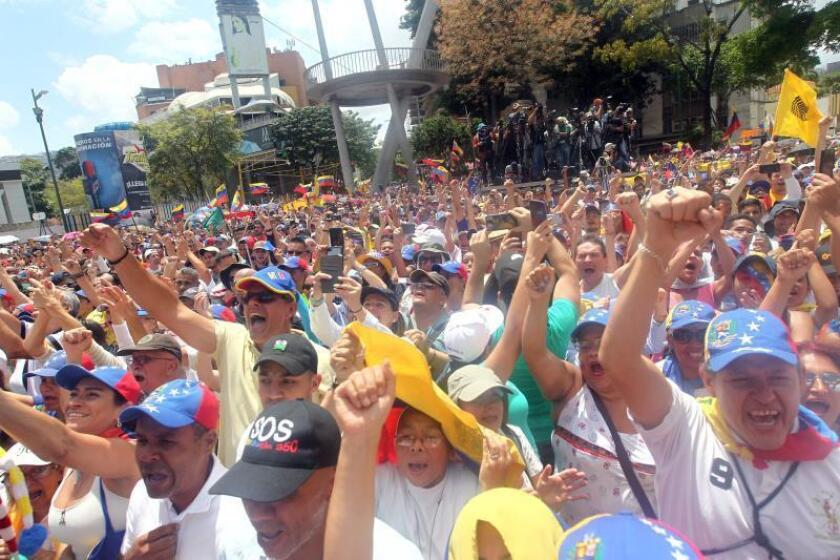 Sympathizers of Venezuelan National Assembly President Juan Guaido attend a rally in Caracas on March 4, 2019, upon his return from a tour of several South American counties. EFE-EPA/ Raul Martinez