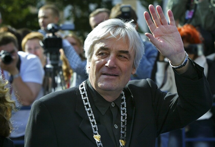 FILE - This is a  Sunday, July 2, 2006 file photo of Polish movie director Andrzej Zulawski, who is chairing the competition jury for the 28th Moscow international film festival,  waves as he arrives for the festival's closing ceremony, Moscow.  Polish film authorities said Wednesday Feb. 17, 2016