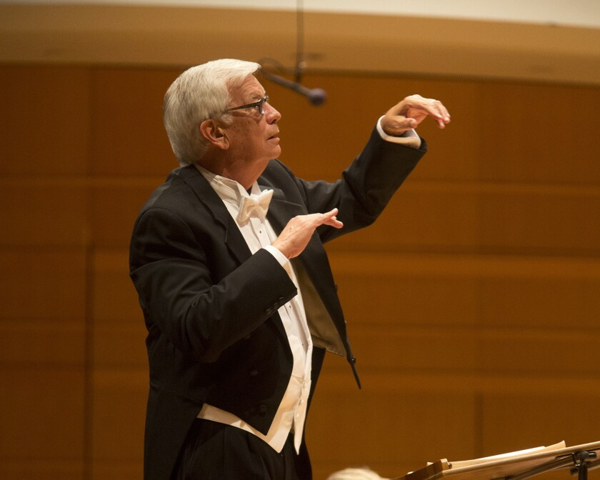 John Alexander conducts the Pacific Chorale.