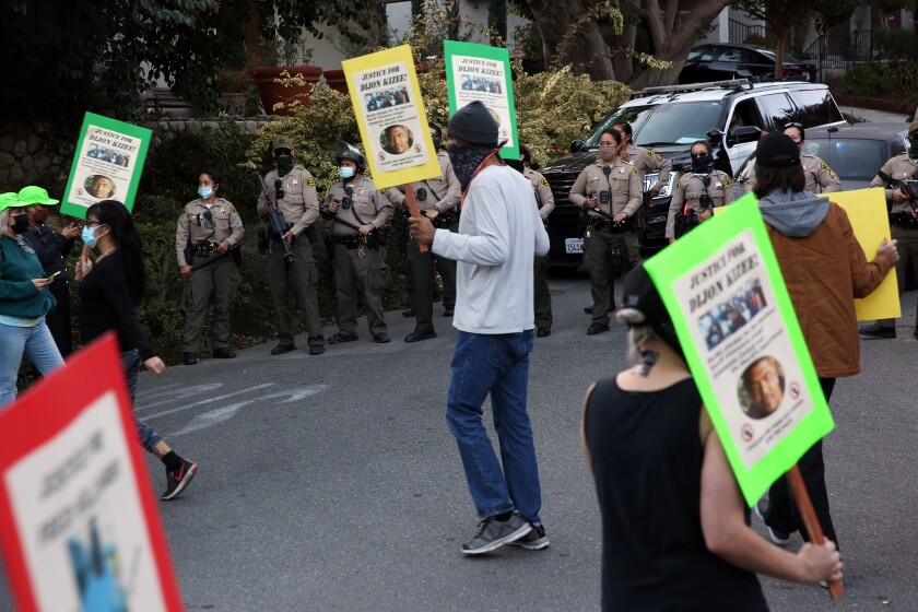 Protesters with sheriff's deputies in the background