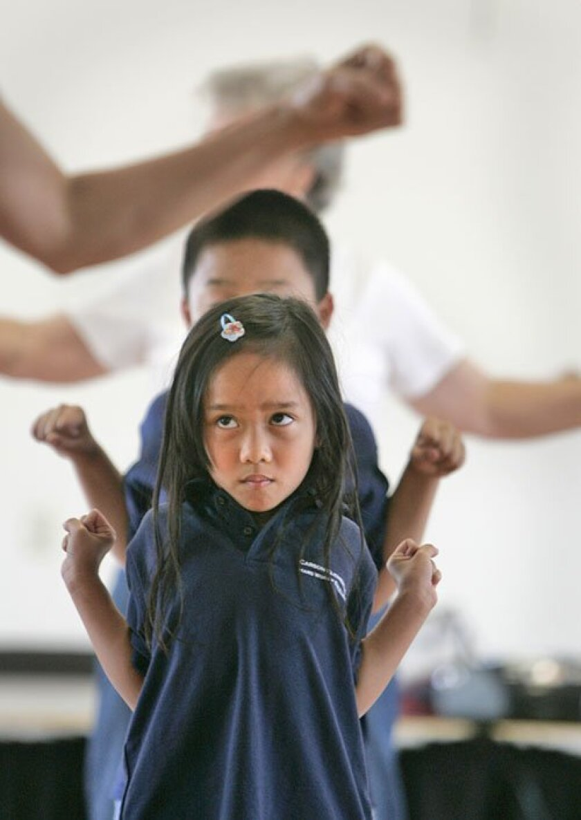 Both seniors and children, such as Sarah and Ben Nguyen, participate in the class. (Peggy Peattie / Union-Tribune)