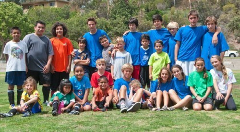 Participants and counselors of Goals for Kids culminate two days of camp at La Colonia Park in Solana Beach. In the back row, far right, are camp founders Jason 'JT' Henderson, 13, and Michael Stewart, 14.