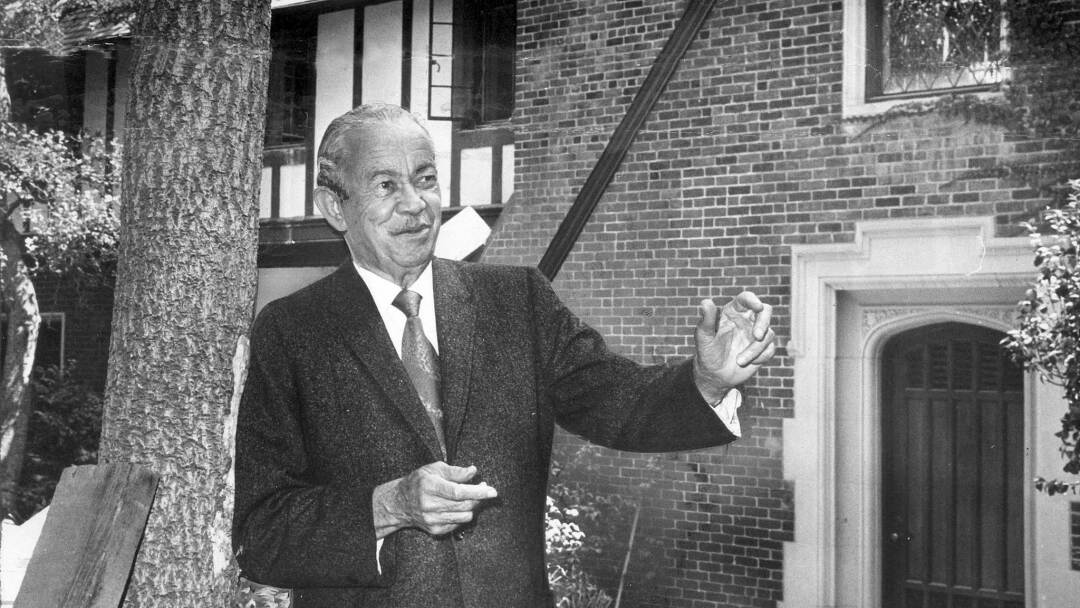 Architect Paul Revere Williams in 1970, standing before a Tudor mansion he designed in 1928.