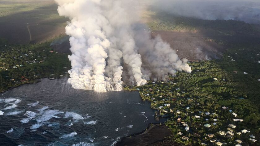 Lava enters Kapoho Bay near Hawaii island's eastern tip on Monday.