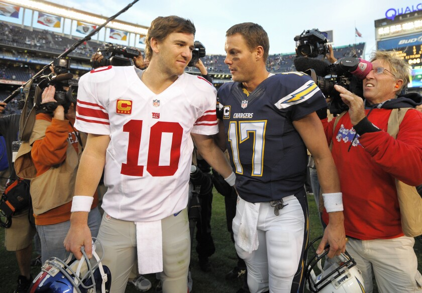 Eli Manning, left,  and Philip Rivers were traded for each other after the 2004 draft.