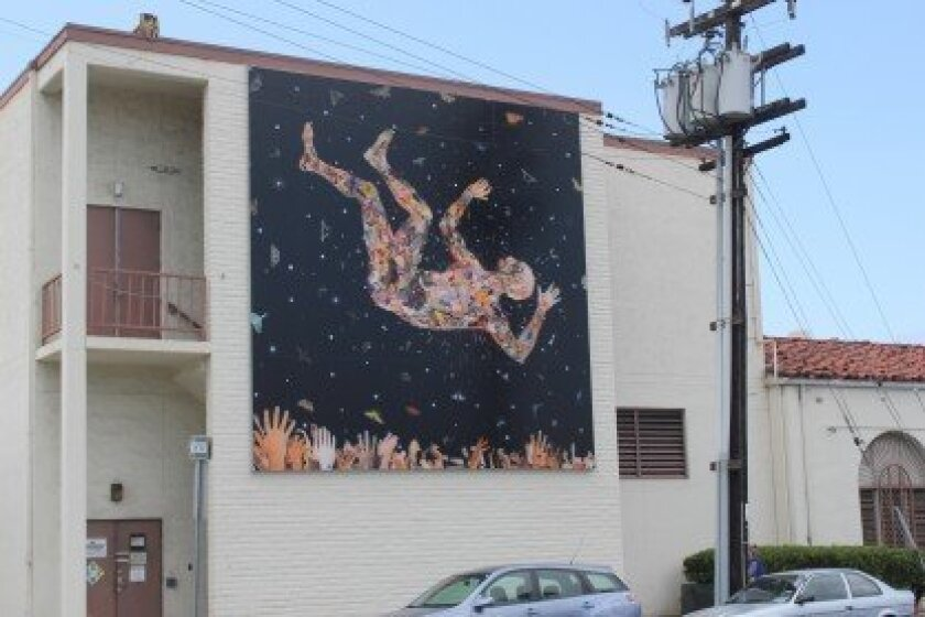 Fred Tomaselli's mural 'Learning to Fly (for the Zeros),' near the corner of Girard Avenue and Torrey Pines Road, was installed April 22. Pat Sherman