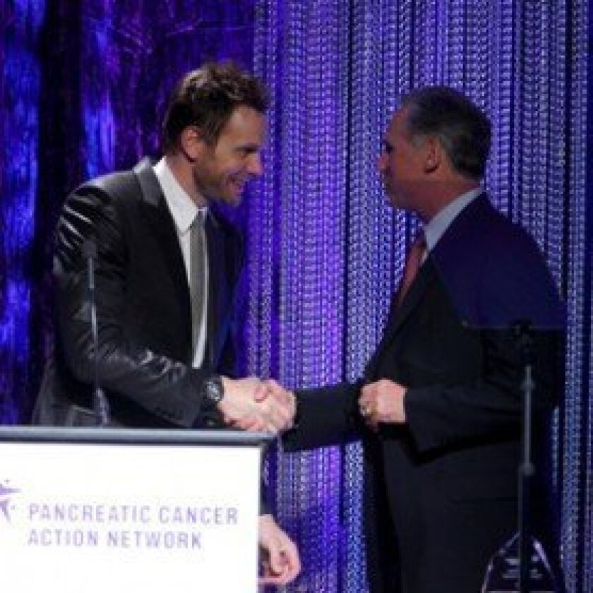 Padres Team Manager and RSF resident Bud Black accepting the award from Joel McHale.