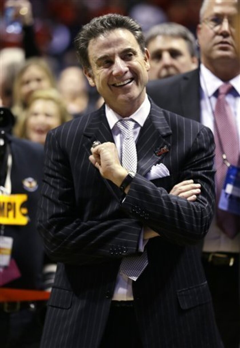 Louisville head coach Rick Pitino celebrates after Louisville defeated Duke 85-63 in the Midwest Regional final in the NCAA college basketball tournament, Sunday, March 31, 2013, in Indianapolis. (AP Photo/Michael Conroy)