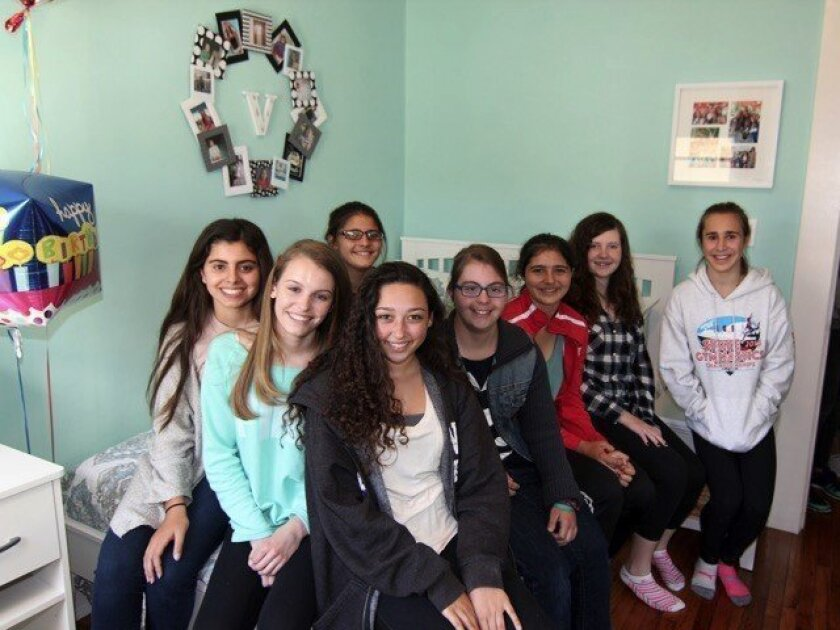 Troop 1224 with Vesna Vasich (in the middle with glasses), the recipient of their room renovation through Cecily's Closet. Courtesy photo