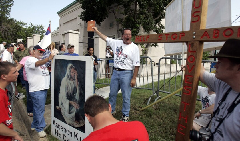 Flip Benham, director of the Christian fundamentalist anti-abortion group, Operation Save America, organized the disruption of Sunday services at the First Unitarian Universalist Church of New Orleans on July 20, 2014. Here, he is shown outside Jackson Women's Health Organization, the only abortion clinic in Mississippi, on July 15, 2006.