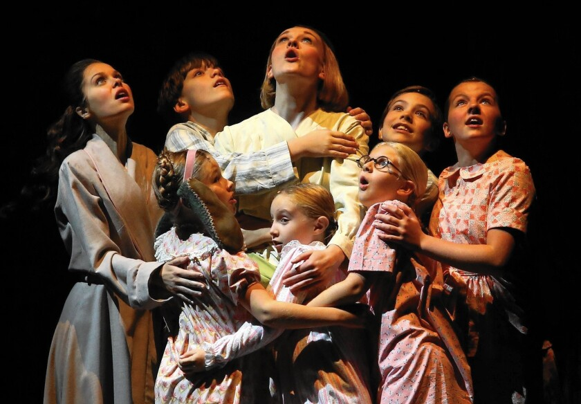 """Maria (Kerstin Anderson) center, back row, and the Von Trapp children in """"The Sound of Music."""""""
