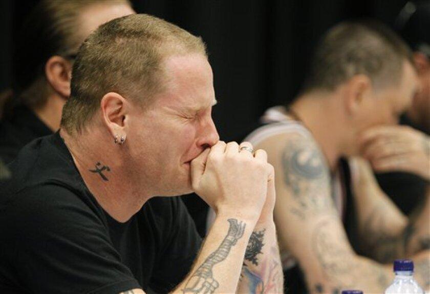 Slipknot members, widow mourn bassist's death - The San