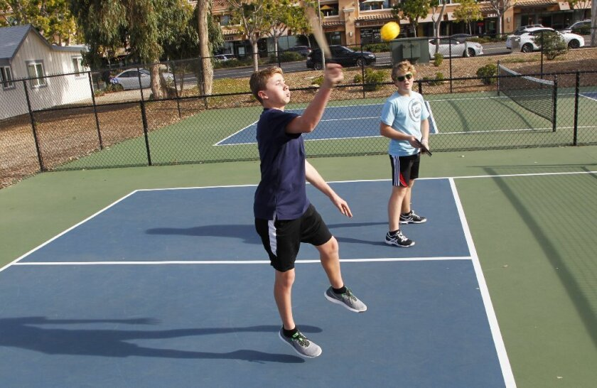 Nash Youngren (left) and Noah Zulick play during the Youth Pickleball Tournament at St. Michael's by the Sea on Tuesday in Carlsbad,