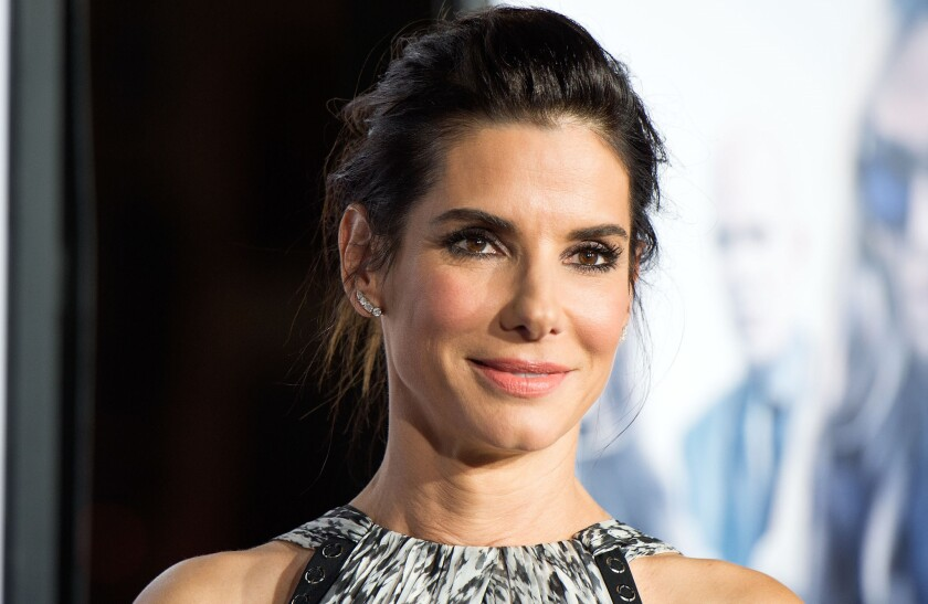 """Sandra Bullock attends the premiere of her latest film """"Our Brand Is Crisis"""" in Hollywood on Oct. 26, 2015. She was accompanied by new beau Bryan Randall."""