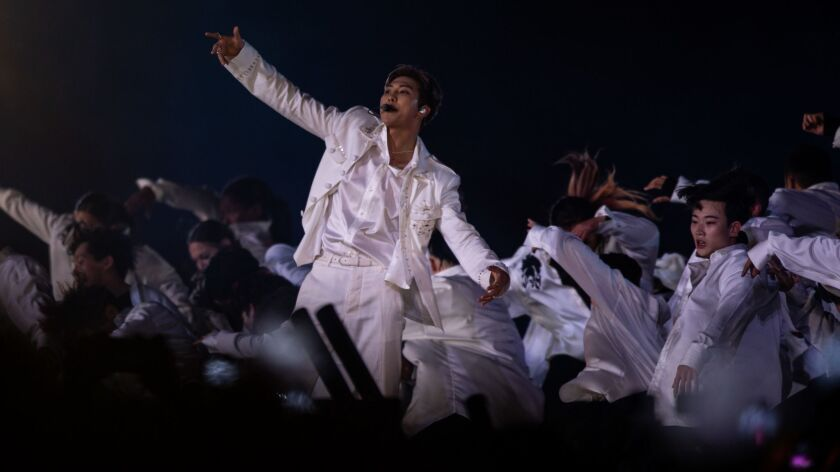 BTS, the new kings of pop, conquer a deafening, sold-out Rose Bowl