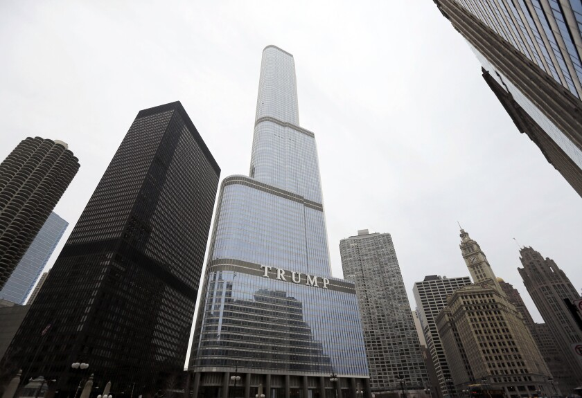 FILE - This Thursday, March 10, 2016 file photo shows the Trump International Hotel and Tower in Chicago. During the four years of Donald Trump's presidency, prices for condos in the building have dropped, down 34%, according to Gail Lissner, a managing director of consultancy Integra Realty Resources. That compares to a 6% drop in the same period for 65 other condo buildings downtown. (AP Photo/Charles Rex Arbogast)