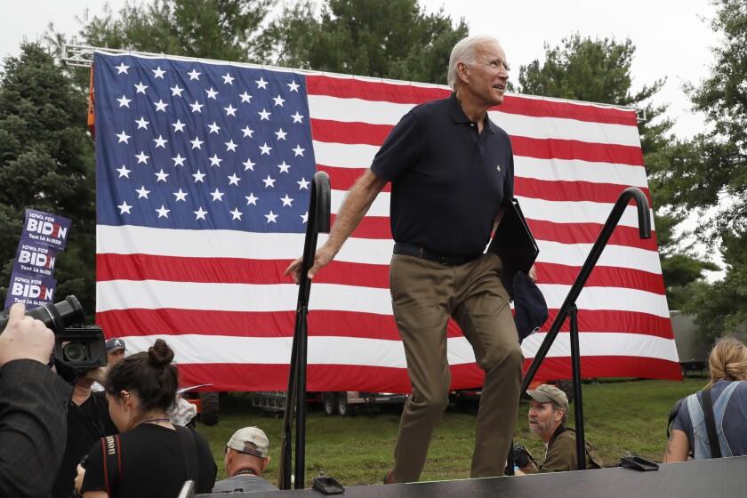 Democratic presidential candidate former Vice President Joe Biden walks on stage to speak at the Polk County Democrats Steak Fry, Saturday, Sept. 21, 2019, in Des Moines, Iowa. (AP Photo/Charlie Neibergall)