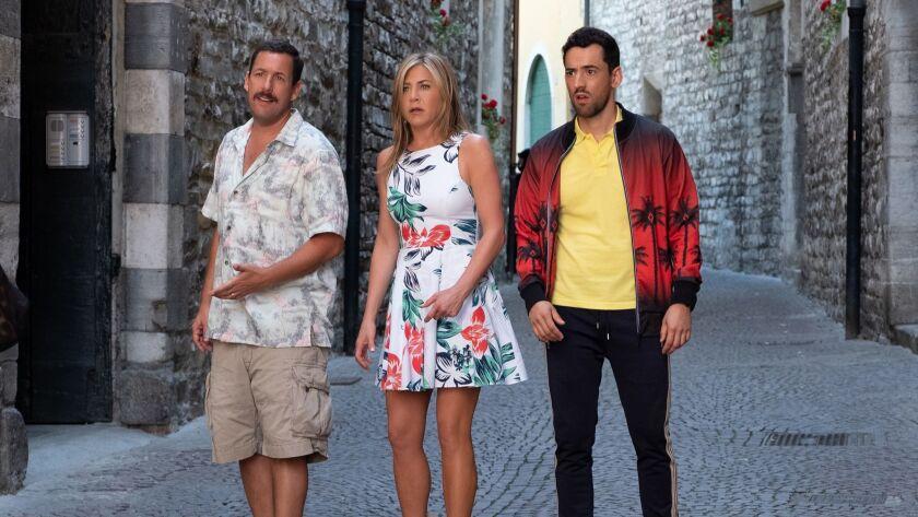 "Adam Sandler, from left, Jennifer Aniston and Luis Gerardo Méndez in the movie ""Murder Mystery."""
