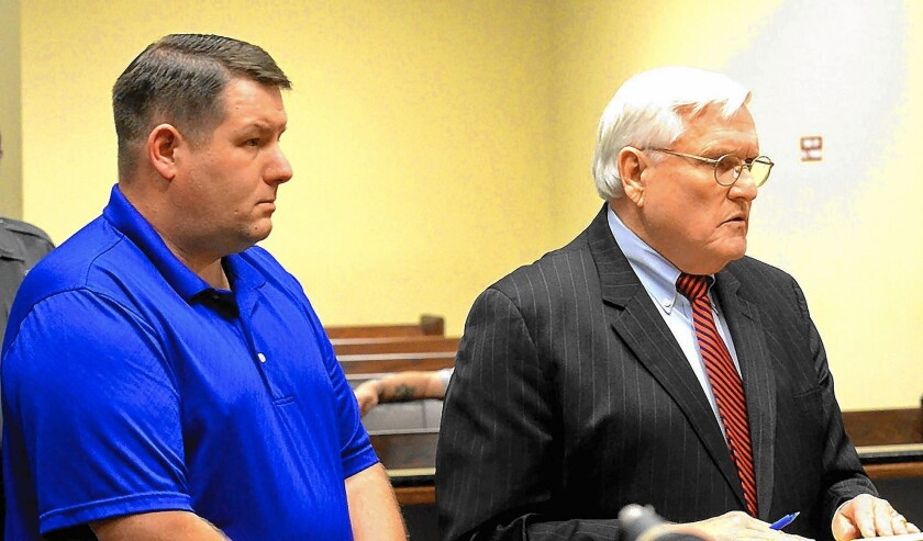 Richard J. Combs, left, the former police chief in Eutawville, S.C., in court with his lawyer John O'Leary. Combs was indicted this month by a grand jury on murder charges in the 2011 shooting of an unarmed black man.