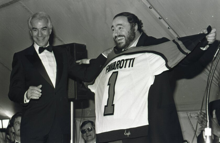 In this March 15, 1985 file photo, opera superstar Luciano Pavarotti displays the Philadelphia Flyers jersey presented to him by Flyers owner Ed Snider, left, after a concert by Pavarotti at the Spectrum in Philadelphia.