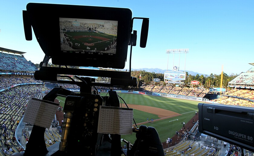 A television camera is trained on the field at Dodger Stadium for the game between the Dodgers and Angels on Monday, Aug. 4, 2014.
