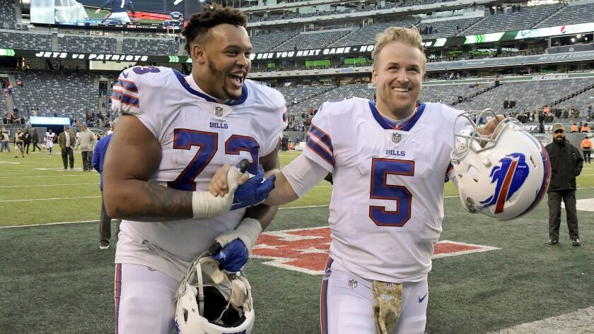Buffalo Bills quarterback Matt Barkley (5) and Buffalo Bills offensive tackle Dion Dawkins (73) walk off the field after a game against the New York Jets on Nov. 11, 2018, in East Rutherford, N.J.