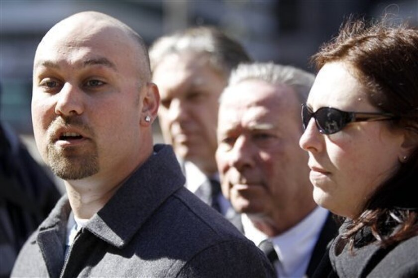 FILE -  March 7, 2011Philip Gaughan, left, accompanied by, from the left, attorney Dan Monahan, his father Philip J. Gaughan, and wife Michelle Gaughan, speaks during a news conference in Philadelphia. Gaughan has a civil suit pending over abuse he said he suffered throughout his high school years