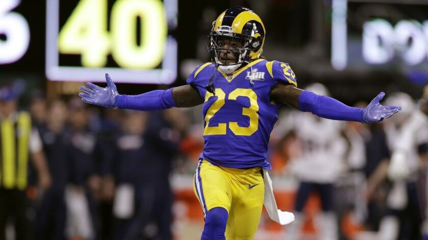 Los Angeles Rams' Nickell Robey-Coleman celebrates after an interception by teammate Cory Littleton