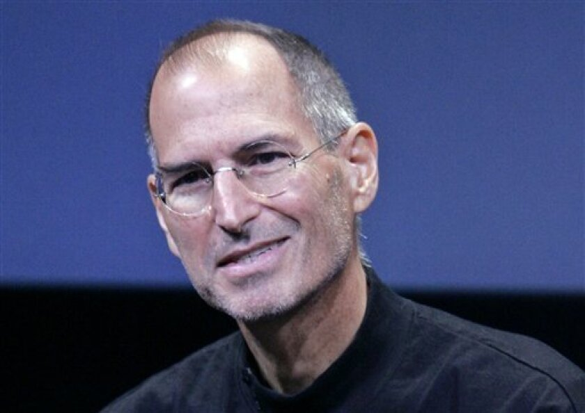 In this Oct. 14, 2008 file photo, Apple CEO Steve Jobs smiles during a product announcement at Apple headquarters in Cupertino, Calif. Jobs on Wednesday, Jan. 14, 2009 said he is taking a medical leave of absence until the end of June. Jobs told employees in an e-mail that his health issues are mo