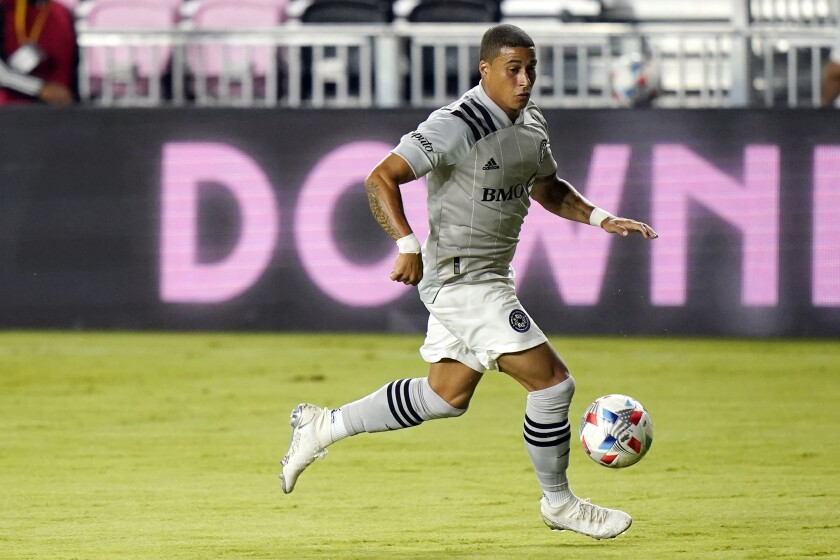 """FILE - In this May 12, 2021, file photo, CF Montréal forward Erik Hurtado dribbles with the ball during the second half of an MLS soccer match against Inter Miami in Fort Lauderdale, Fla. CF Montreal traded Erik Hurtado to the Columbus Crew on Friday, July 9, 2021, for $200,000 in general allocation money, saying the fact the veteran American forward was not vaccinated played into the deal. Montreal sporting director Olivier Renard said the MLS team was """"satisfied"""" with Hurtado's work, but his """"situation was problematic."""" (AP Photo/Lynne Sladky, File)"""