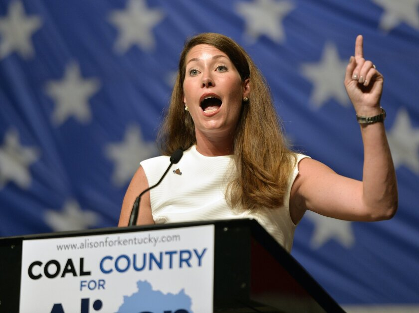 FILE- This Aug. 8, 2014, file photo shows Kentucky Democratic senatorial candidate Alison Lundergan Grimes as she speaks to a group of supporters during a political rally at the Hal Rogers Center in Hazard, Ky. Grimes will face Senate Minority Leader Mitch McConnell in the general election for U.S. Senate. (AP Photo/Timothy D. Easley, File)