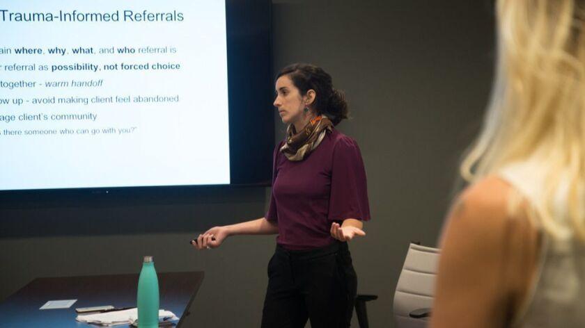 Jessica Roach, program coordinator for Survivors of Torture International, leads a trauma-informed care workshop at 2-1-1 San Diego.