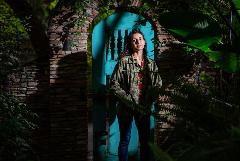 Author Ottessa Moshfegh poses for a portrait in the lush gardens surrounding her home.