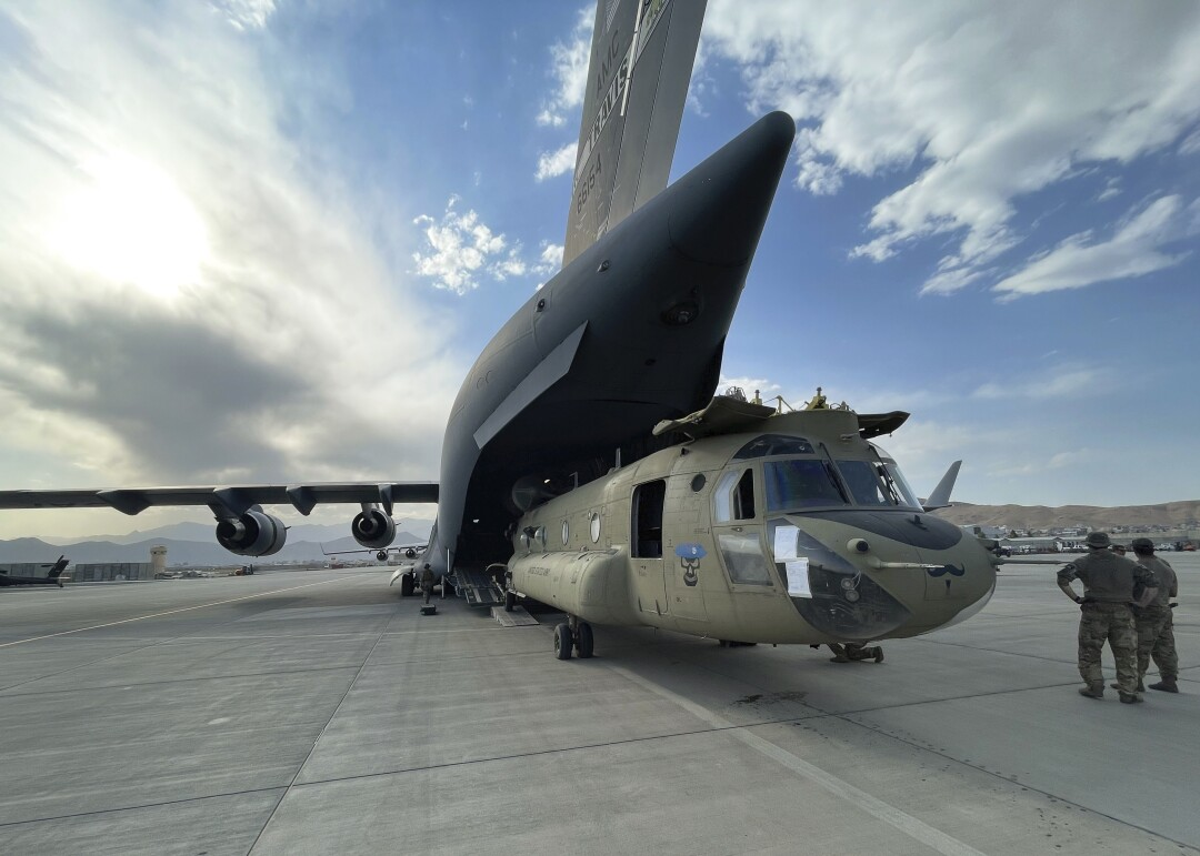 A CH-47 Chinook from the 82nd Combat Aviation Brigade, 82nd Airborne Division is loaded onto a U.S. Air Force C-17