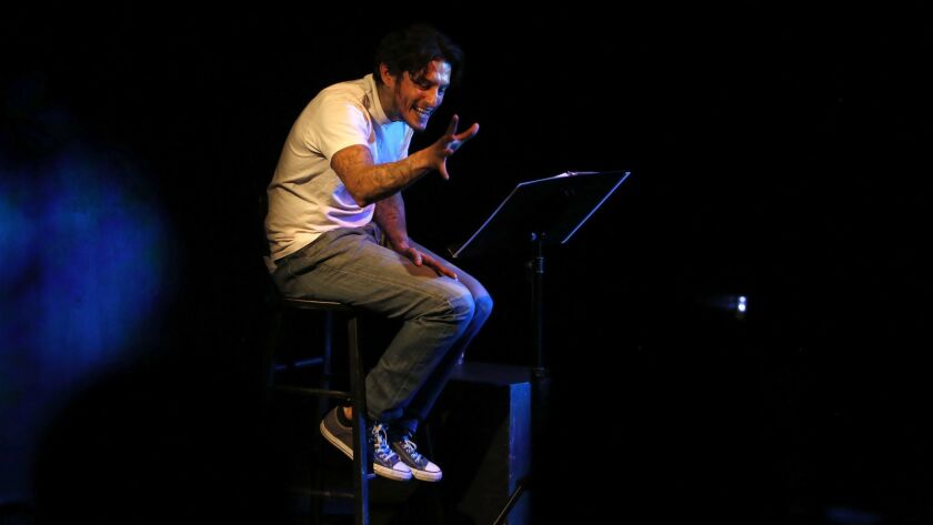"""Richard Cabral performs """"Time Alone"""" at the Pico Playhouse, in front of high school students from South Los Angeles."""