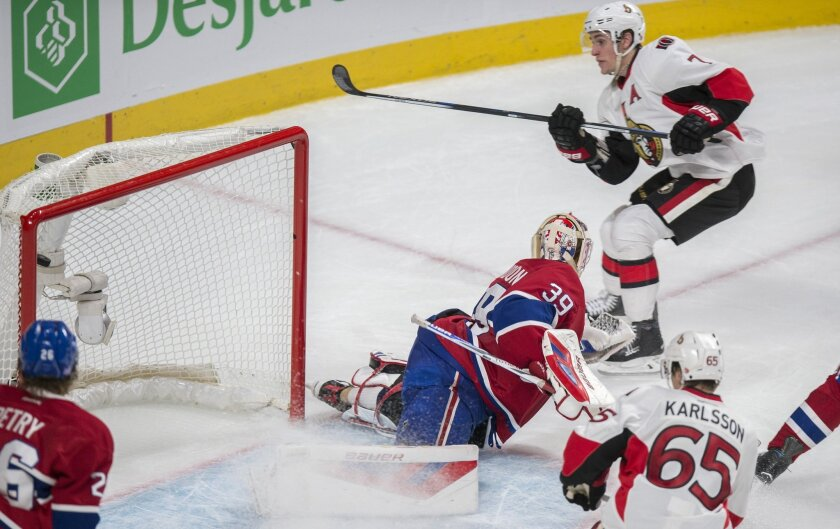 Ottawa Senators' Kyle Turris, right, scores on Montreal Canadiens goalie Mike Condon during overtime of an NHL hockey game Tuesday, Nov. 3, 2015, in Montreal. (Paul Chiasson/The Canadian Press via AP)