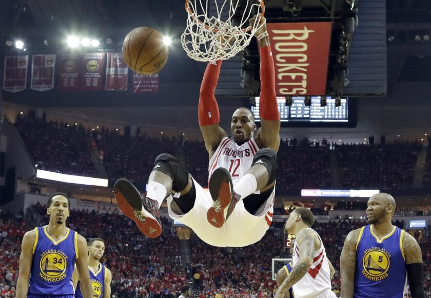 FILE - In this April 24, 2016, file photo, Houston Rockets' Dwight Howard dunks against the Golden State Warriors during the first half in Game 4 of a first-round NBA basketball playoff series  in Houston. Toronto's DeMar DeRozan, Atlanta's Al Horford, Memphis point guard Mike Conley and Houston's