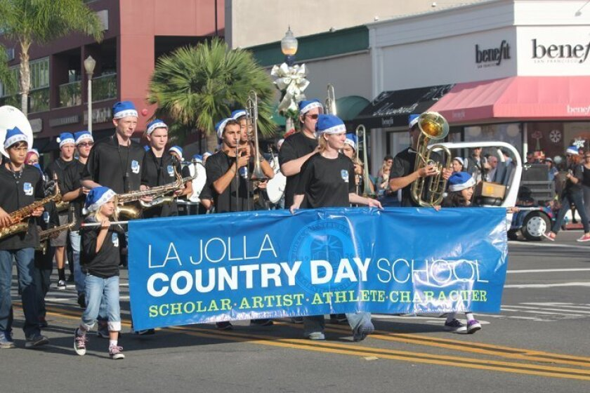 The La Jolla Country Day School Marching Band takes part in the La Jolla Christmas Parade and Holiday Festival on Sunday, Dec. 7, 2014.