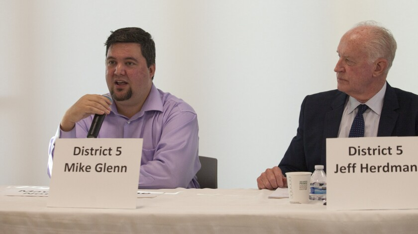 Mike Glenn, left, speaks during a Newport Beach City Council candidates' forum in 2016.