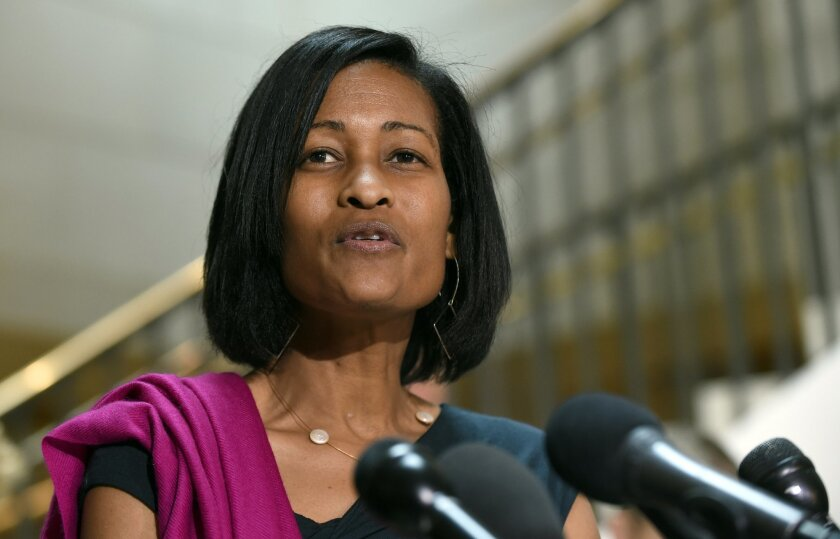FILE -In this Sept. 3, 2015, file photo, Cheryl Mills speaks to reporters on Capitol Hill in Washington. A court deposition released by a conservative legal group shows that Mills, a veteran aide to Democratic presidential candidate Hillary Clinton discussed Clinton's private email server with a te
