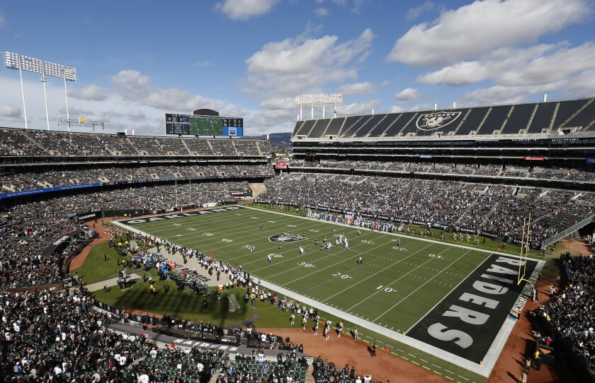 Fans watch from a general view at Oakland Alameda County Coliseum during the first half of an NFL football game between the Oakland Raiders and the Indianapolis Colts in Oakland, Calif., Sunday, Oct. 28, 2018.